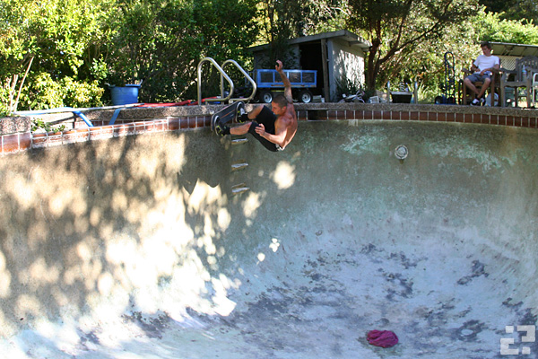 Dan Robinson over the ladder of the newly drained pool. Photo: Aaron Robinson