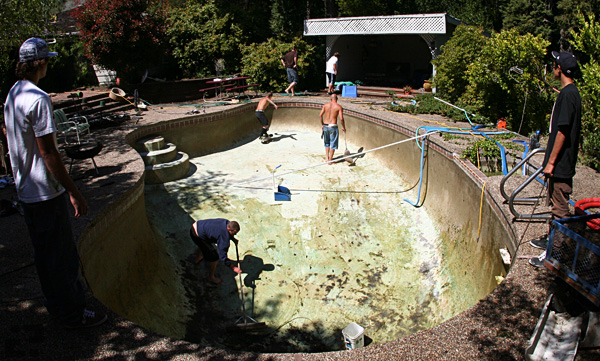 Scum Pool in the mountains near Santa Cruz getting drained.