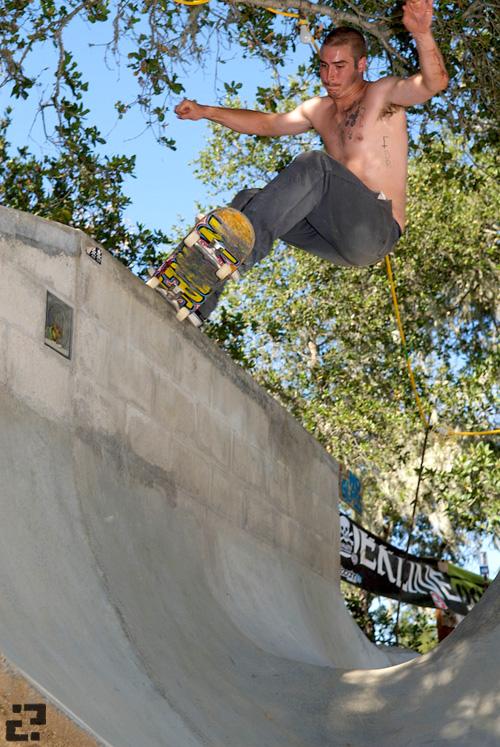 Adam Benson 5-0 grinding the vert wall.