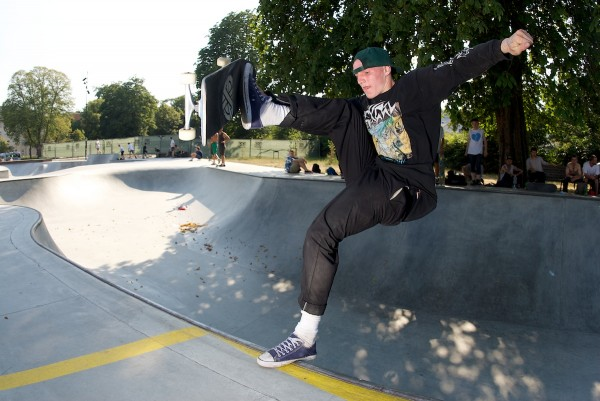 Jake Snelling (England) sweeping the leaves up in the snake run concrete mini ramp shallow end.