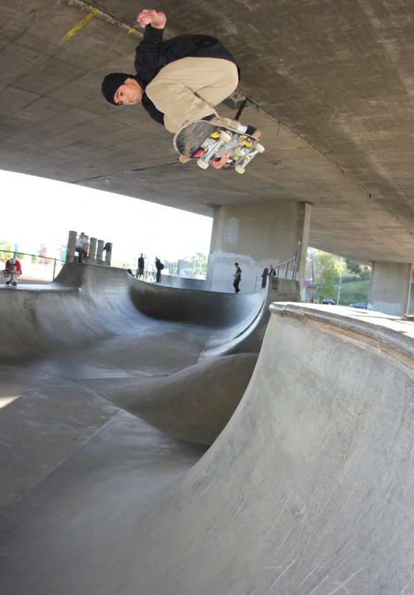 Robbie Russo goes indy over the hip at San Pedro´s old channel street skatepark section.