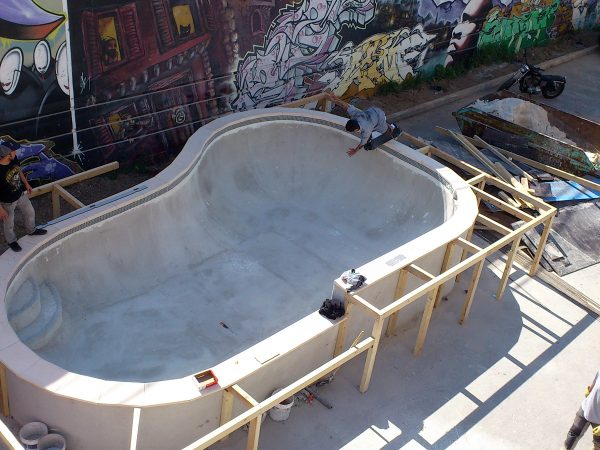 Julien Benoliel taking his first runs in the bowl he designed as the concrete is still drying. Backside disaster.