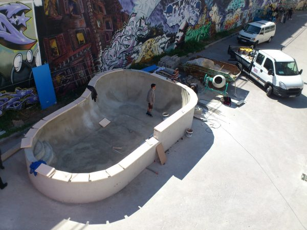 Putting in the pool coping.