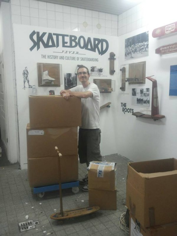 Jürgen Blümlein setting up the Skateboard Fever exhibit.