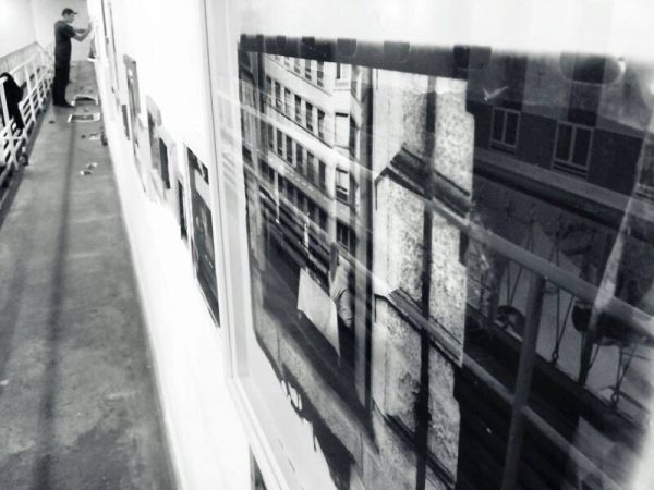 Sergej Vutuc's photos going up on the wall.