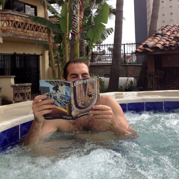 Bailey catching up on Confusion back issues while soaking in the tub.