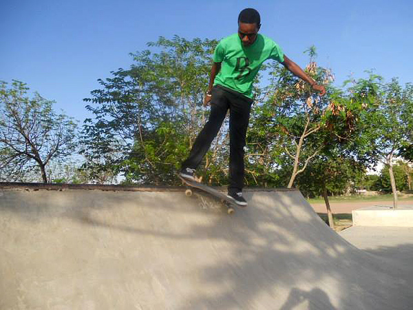 Gideon Lyimo. Backside grind on the quarter.