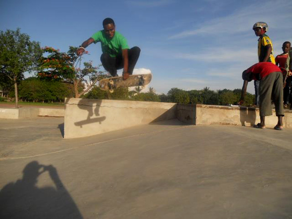 This is Gideon Lyimo, Tanzania's best skateboarder. He didn't compete in the contest because there was no any one to stand against him. At the end I gave him 10000 Tanzania shillings (5 euros)  to motivate him to keep skating. I believe he will be countries first pro skater. Shown here with a boneless to the bank. He is also my assistant.