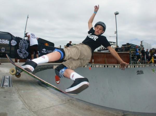 Cory Juneau. Frontside rock slide and roll.