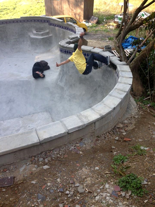 Honda. FS grind in their recently finished backyard pool they built.