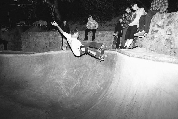 Dave Friel. Frontside grind in the corner.