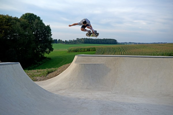 Kupa. Backside melon grab off the hip and over the loveseat over the trees in the german countryside.
