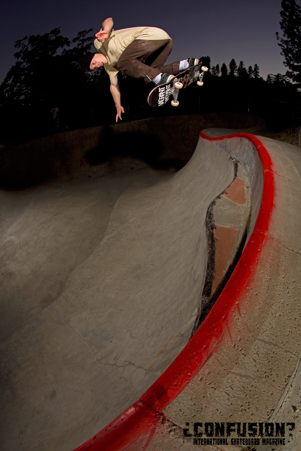 Frank Shaw backside ollie over the loveseat in the oververt pocket in Jacksonville, Oregon.  Photo: Garric Ray