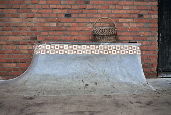How wouldn't want a quarter pipe with a hip and pool coping built up against their house? Matt wanted one, so he built it.