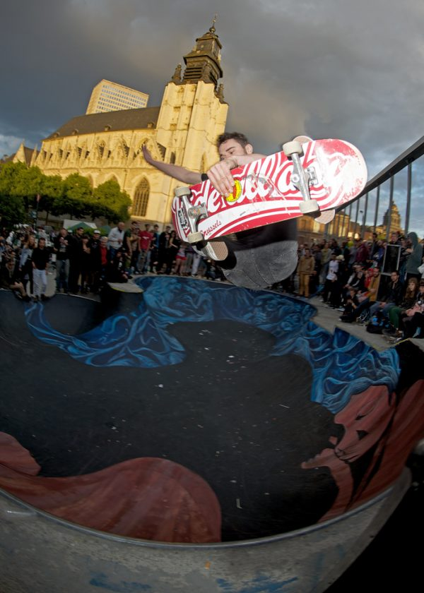 Big frontside air beneath an ominous sky in the shadows of the church. Name unknown.