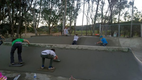 Kids learning how to work for their skate spot.