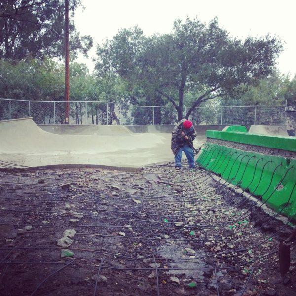 Mark Hertenstein working in the rain.
