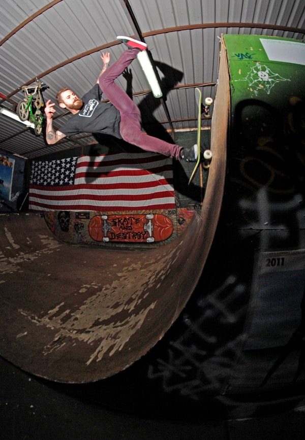 Angelito. One foot to fakie on his own ramp.