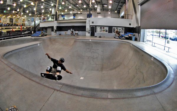 Mike Serna. Frontside grind at the Combi replica in Orange, California.