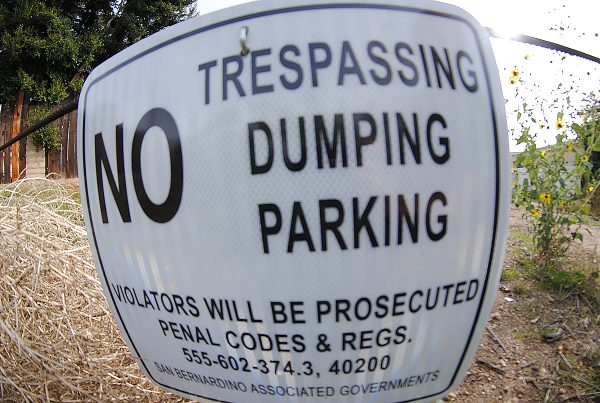 NO TRESPASSING. NO DUMPING. NO PARKING.