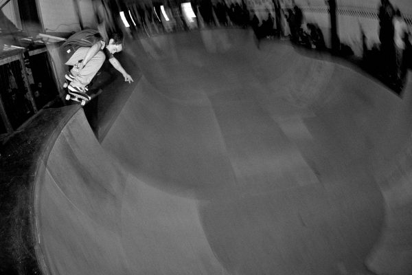Alain Saavedra. Ollie up from the lower deck up over into the bowl.
