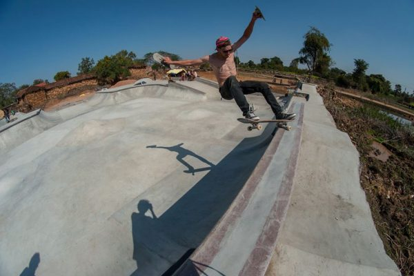 Baumi. Frontside grinding his own creation with trowel in hand.