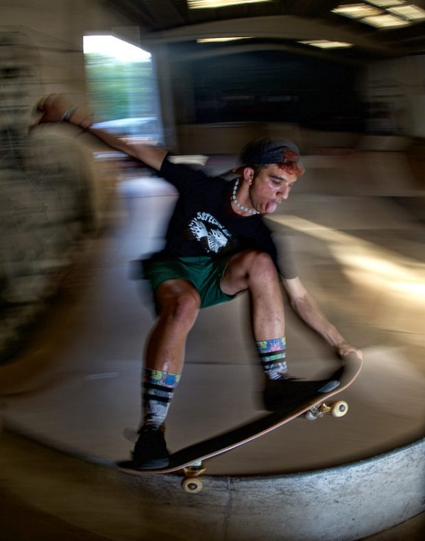 Hugo. Standing up and grabing his nose grinding some pool coping.. rappappap.